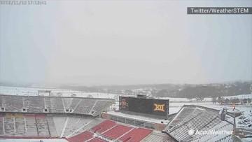 Snow falls above Iowa State's Jack Trice Stadium