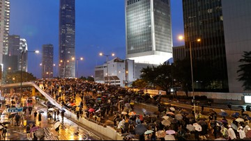 Police keep low profile at huge, peaceful Hong Kong protest