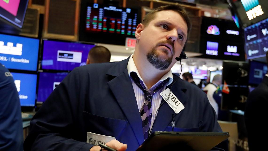 Stocks slide on Wall Street, extending steep drops this week