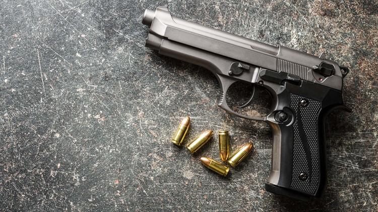 9mm pistol bullets and handgun on black table