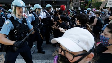 Protesters clash with police in Chicago, several squad cars damaged