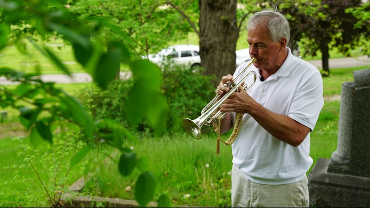 Gary Marquardt plays Taps at Oak Hill Cemetery