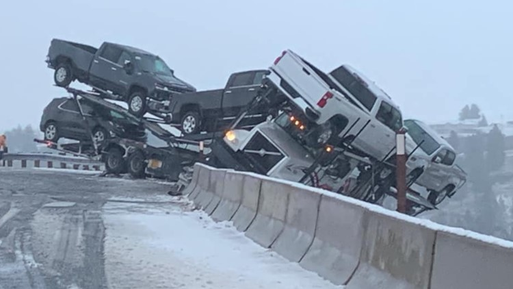 Semi nearly plunges into canyon after icy crash