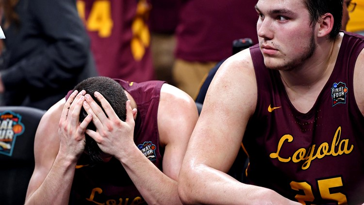 Loyola Ramblers guard Clayton Custer (13) and center Cameron Krutwig (25) react on the bench during the second half against the Michigan Wolverines in the semifinals of the 2018 men's Final Four at Alamodome.