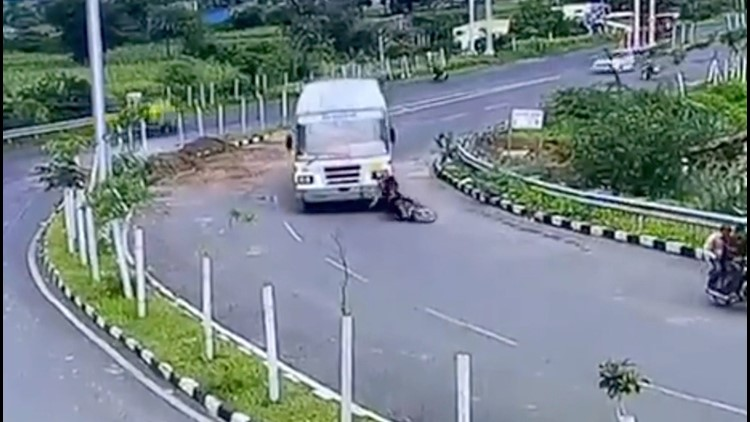 Motorcyclist Hit by a Bus, Miraculously Emerges Unharmed From Beneath Its Wheels