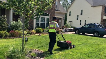 An elderly woman was struggling to mow her lawn. Firefighters stepped in to help