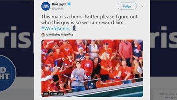 Man double fisting beer at the World Series uses chest to catch the ball