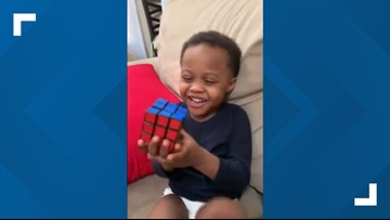 Boy genius! Watch as a 3-year-old boy solves Rubik's Cube