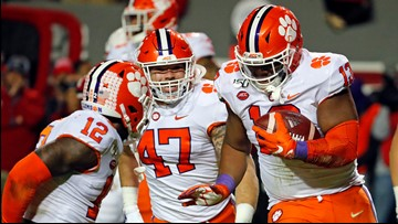 Clemson tops NC State 55-10, wins ACC division title