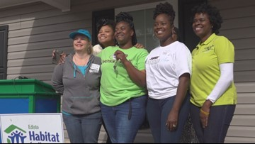 A Home for the holidays,  local mom receives a home from Habitat for Humanity