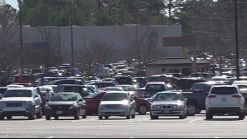 Shoppers rush to the stores for last minute buys on Christmas Eve