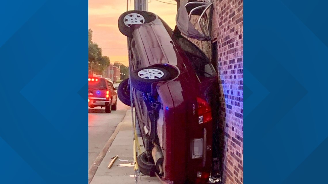 Car in precarious position after crashing in Sumter