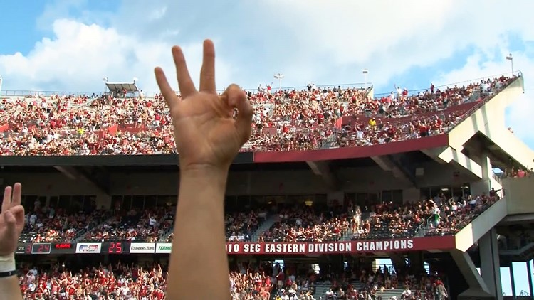Gamecocks fans throw up three fingers in love, support