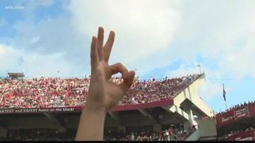 South Carolina Gamecocks fans raise three fingers for Tyler Hilinski