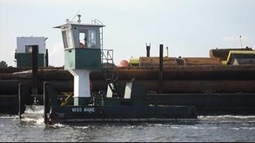 Capsized work boat located in Charleston Harbor, salvage efforts underway