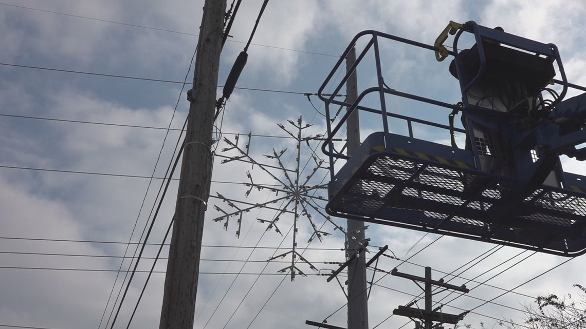 Irmo workers hang Holiday decorations on streets