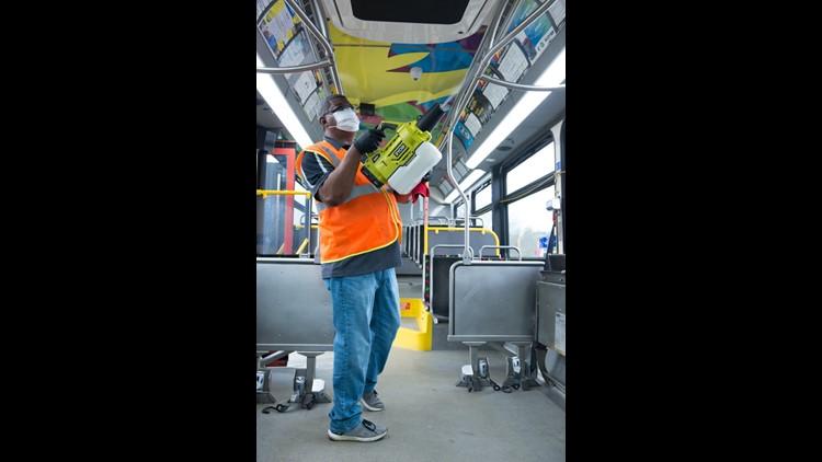 Comet employee disinfects bus