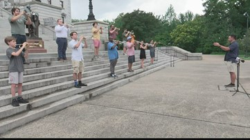 Trumpeters gather to play Taps at State House