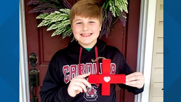 Local 5th-grader makes 'Crosses with Heart' to honor healthcare workers, first responders