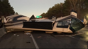 Traffic moving again on I-20 after RV overturns, leaks fuel