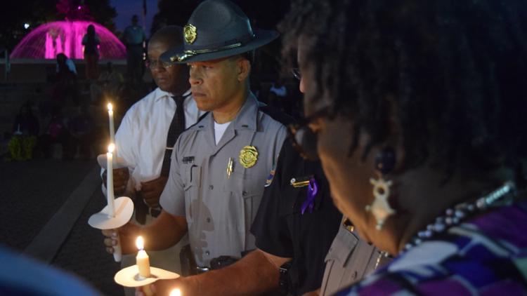 Candlelight vigil aimed toward domestic violence awareness