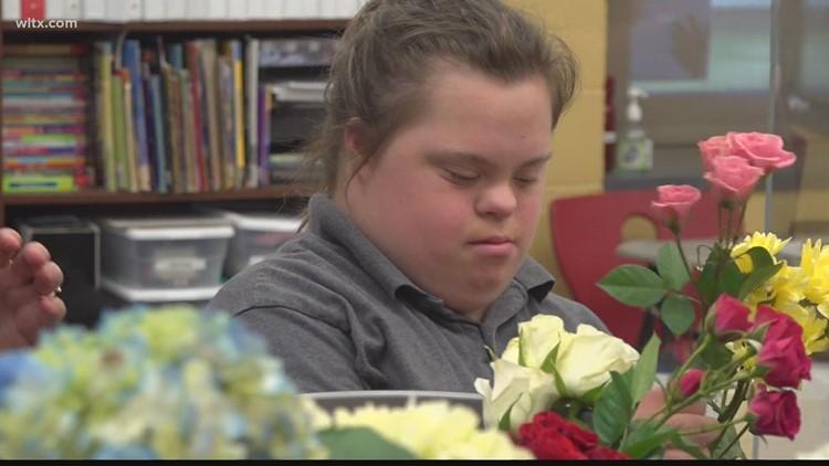 Midlands high school students learn skills by working in school 'flower shop'