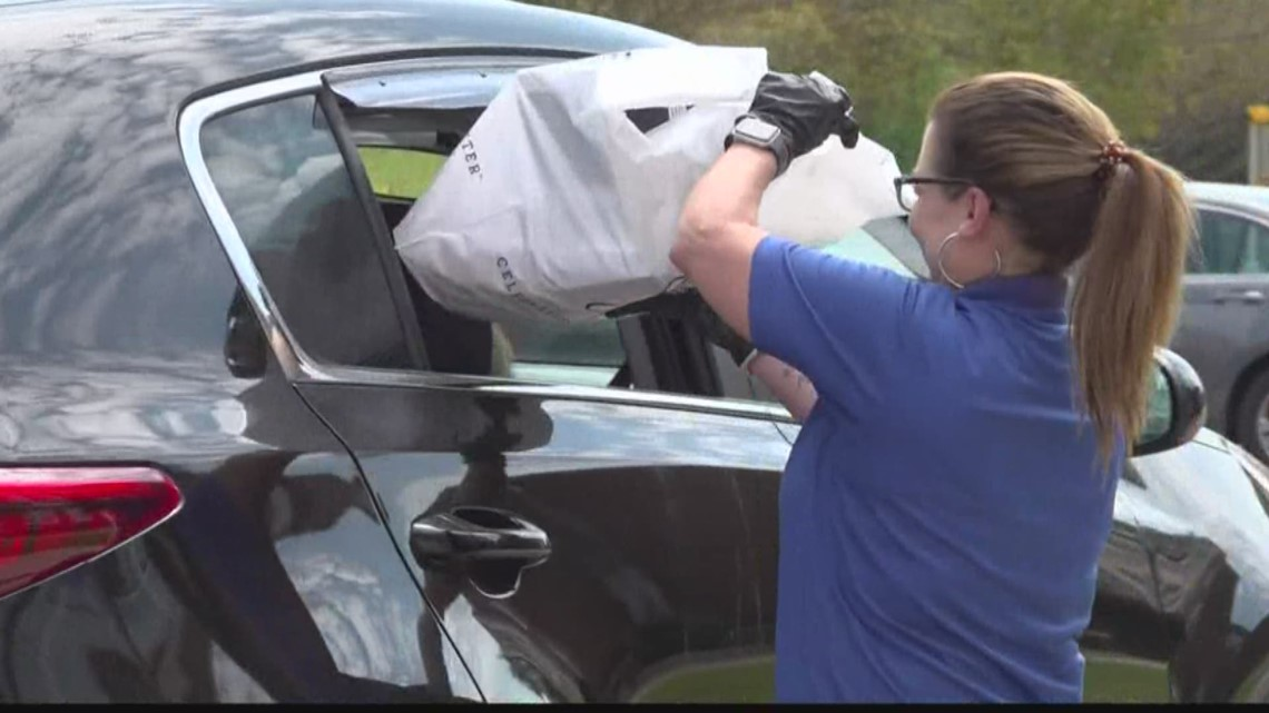Brookland-Cayce High Seniors have drive-thru pick up for caps and gowns