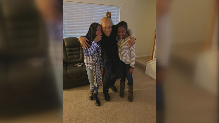 Amirah (on the left) with her father and sister playing around