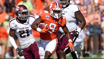Clemson, Lawrence dominate 12th-ranked Aggies 24-10