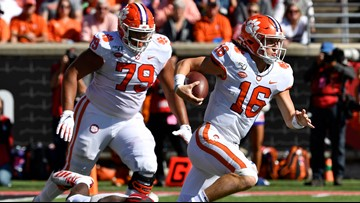 Lawrence, Etienne lead Clemson to 45-10 rout of Louisville