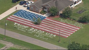 Giant American flag, 'Trump  2020' painted on lawn in Plant City