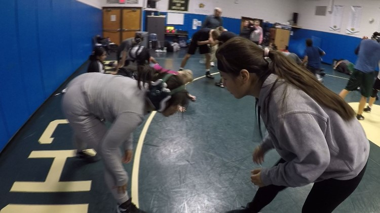 Fairfax County high school wrestling coach breaks barriers by going to the mat for her team