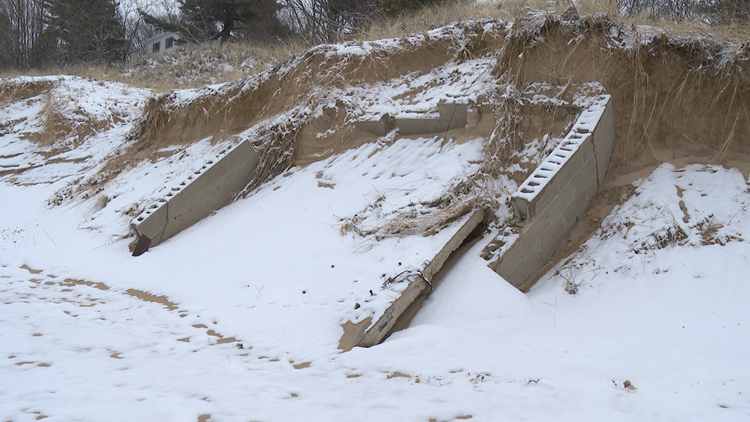 Waves carve controversial wartime history, buried for 63 years, from Michigan dune